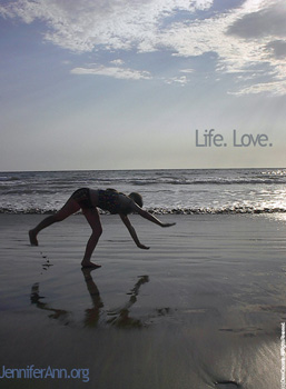Picture of Jennifer Ann Crecente at the age of 14 performing a cartwheel in the surf in Mazatlan, Mexico.