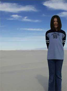 Picture of Jennifer Ann Crecente at the age of 13 standing on gypsum sand with blue skies above her in White Sands, New Mexico.